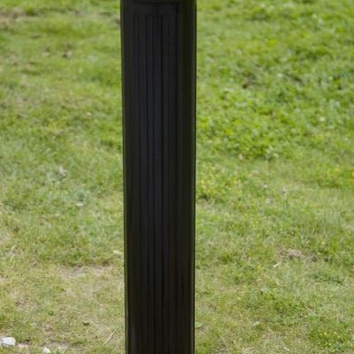 ornate black polymer bollard installed on a grassed area