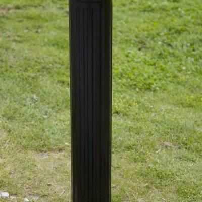 ornate black polymer bollard installed on a grassed area