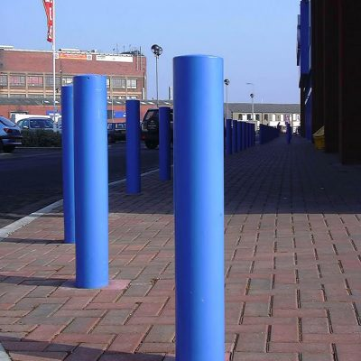 blue mild steel powder coated bollard in a retail park