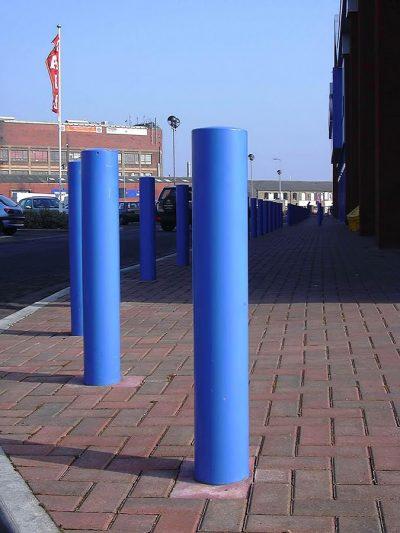 blue mild steel powder coated bollard in a retail park