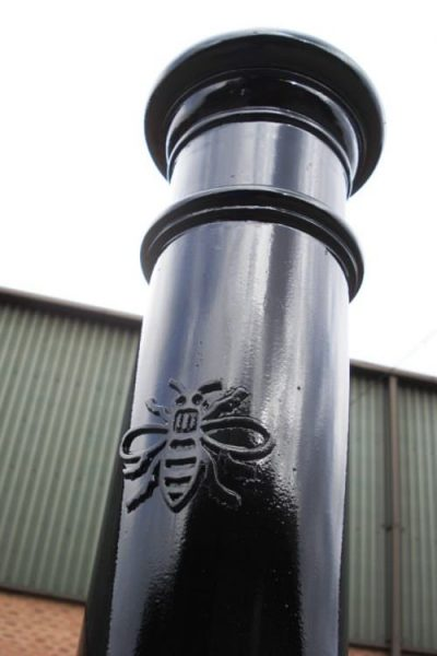 manchester polymer bollard with bee detail on it