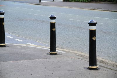manchester polyurethane bollards on a street in front of a school