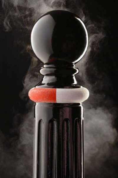 black bollard made from polyurethane with red and white band