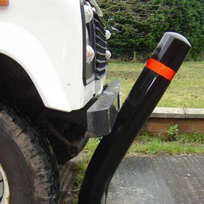 car bumps into a flexible polymer plastic bollard
