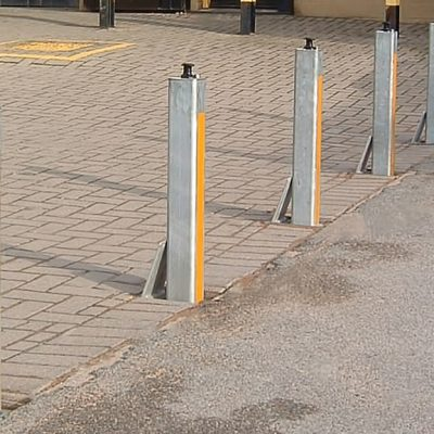 galvanised telescopic bollard in a row with yellow reflective banding