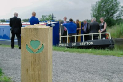 logo etched bollard with the wigan heart on a thick timber oak bollard