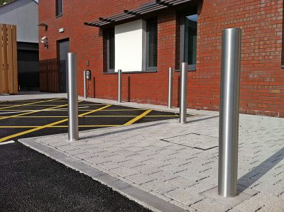 round stainless steel bollards installed on a new building site