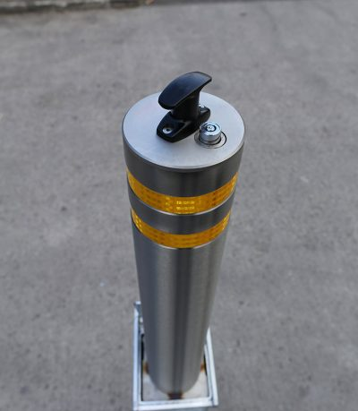 top handle and lock on a stainless steel reflective banded telescopic post