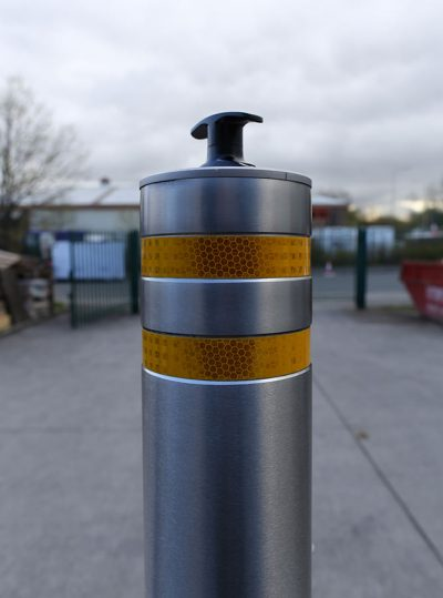 reflective bands on a telescopic stainless steel bollard