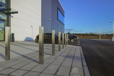 square protection bollards in stainless steel infront of a warehouse unit