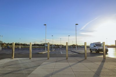 wide view of a row of square stainless steel bollards