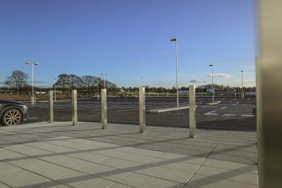 row of square stainless steel bollards