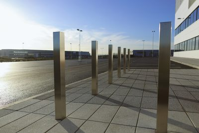 row of square stainless steel bollard on a new development
