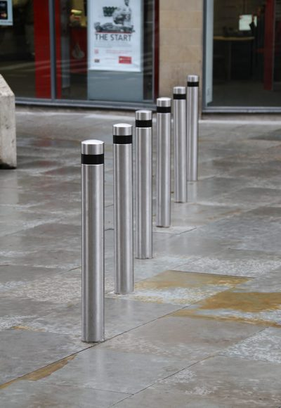 stainless steel banded bollards on a high street