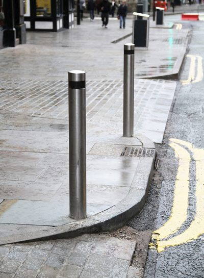 roadside stainless steel bollard with black banding for visability