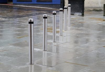 row of stainless steel reflective bollards