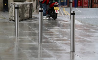 black banded bollard in stainless steel to prevent cars from entering an area