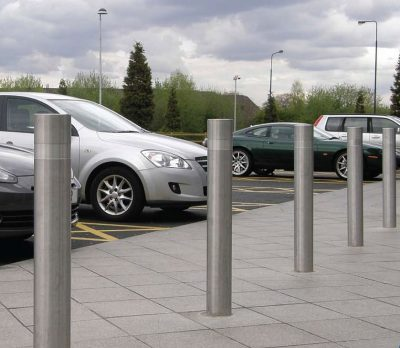 row of stainless steel bollards with a rebate