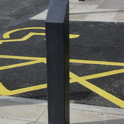 Bloc mild steel bollard protecting a pavement