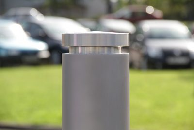 shot peaned and stainless steel bollard top of a bollard