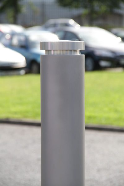 a machined top stainless steel bollard showing a bruched satin finish and shot peaned texture