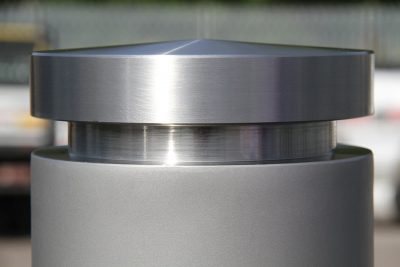 shot peaned and brushed satin finish close up on a bollard
