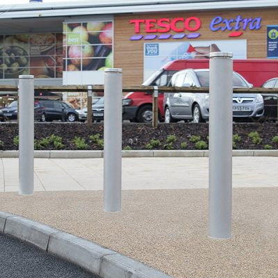toner stainless steel bollard sitting in front of a tesco super store