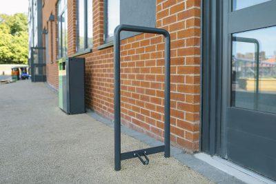 small school door protector to prevent a door from opening in a full swing