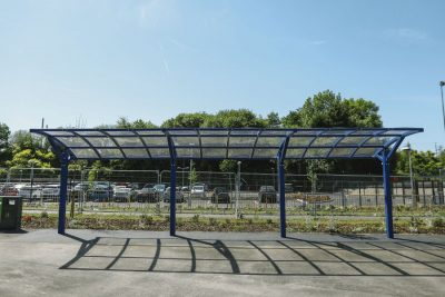 front facing a large canopy installed at a school