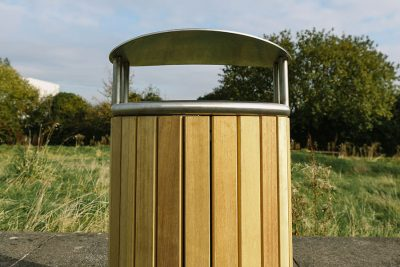 timber and stainless steel litter bin outside on a path