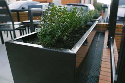 outdoor steel planter in a pub garden