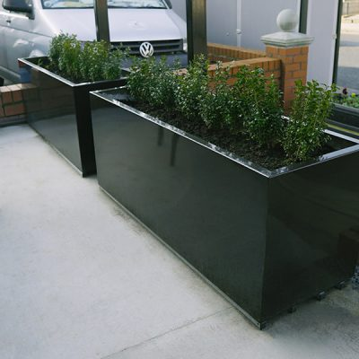 steel planter with plants planted in it