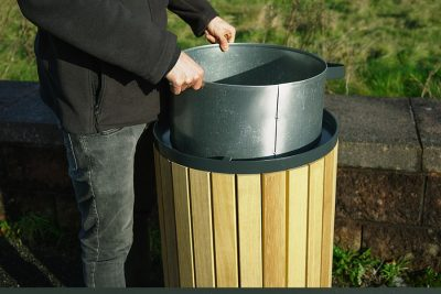 glavanised liner being pulled from a litter bin