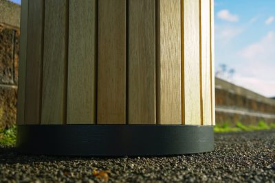 base of a timber bin outside on a path