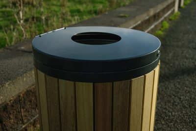 lid section of outdoor timber and steel litter bin on a street